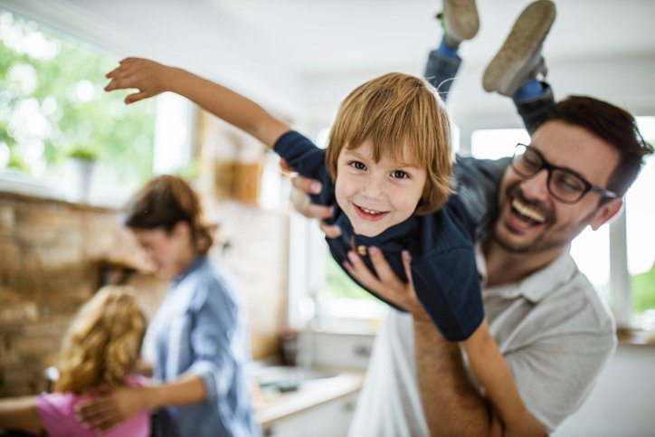 appy child with father in kitchen - top rated portsmouth nh cpa accounting services firm
