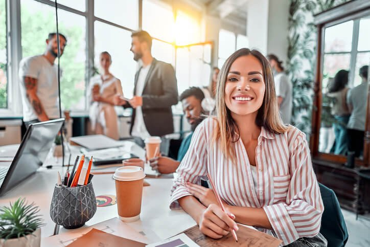 smiling female coworking employee - best cpa accounting services firm in north hampton nh